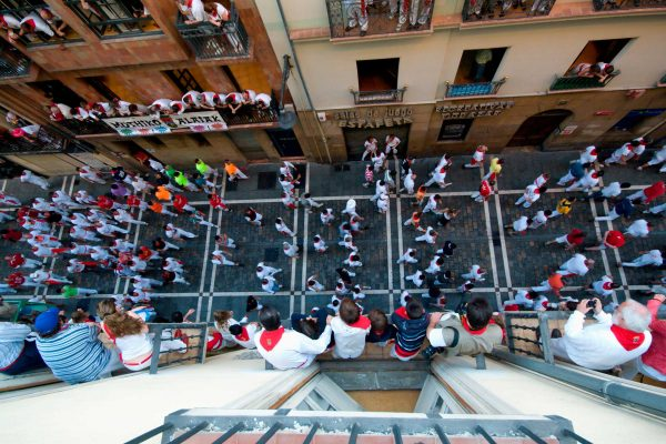 Running of the bulls in Estafeta street, see it from a balcony with Paladar y Tomar