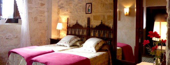 Deliciously decorated rustic rooms at Santa Petronila wine estate