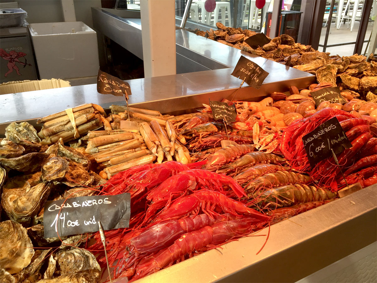 The stunning fish and seafood stall offers tapas degustation